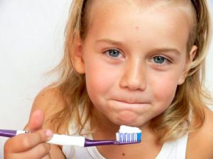 Cosmetic Dentistry Tips for Kids brush