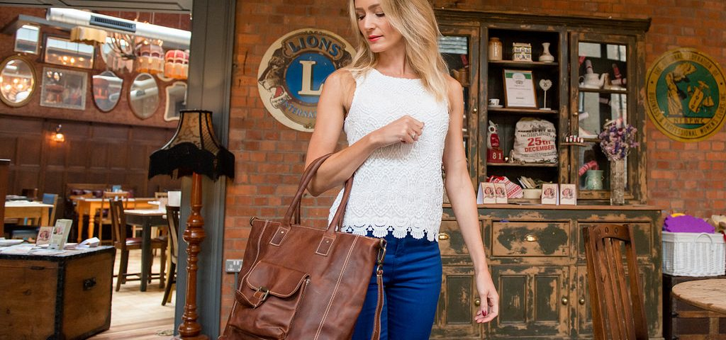 woman brown leather bag