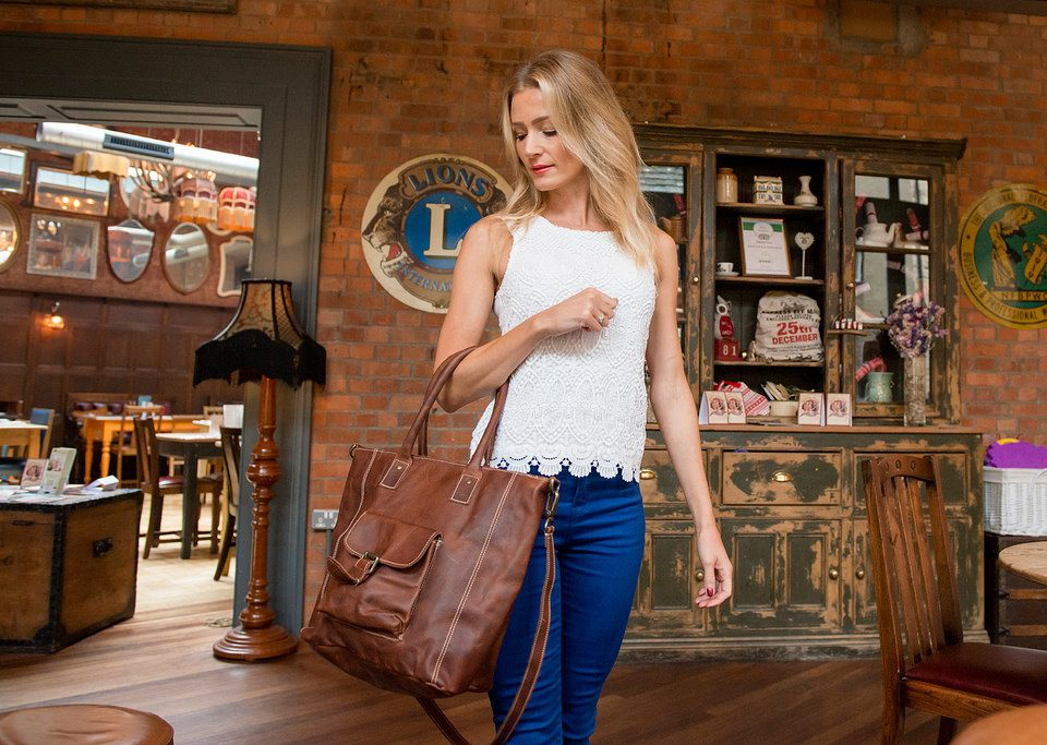 woman brown leather bag
